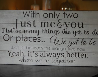 Jack Johnsons -Better together lyrics painted on barn wood.