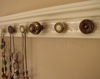 jewelry holder This wall necklace organizer w/7 decorative cabinet knobs  on off white background 20*