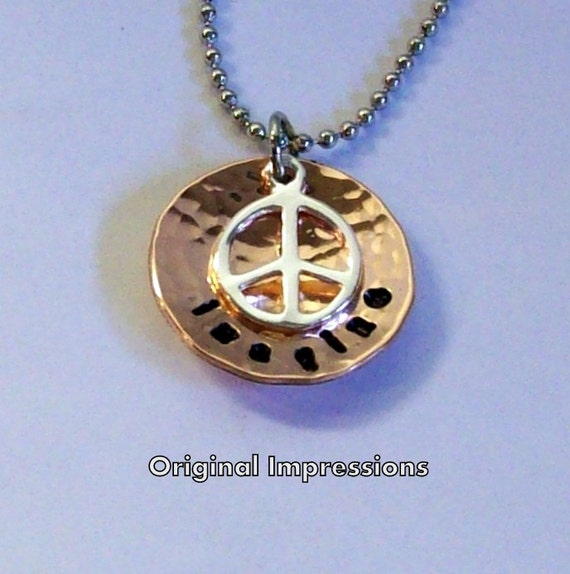 Imagine peace pendant necklace of hammered and cupped copper with a sterling silver peace symbol charm on a stainless steel bead chain.