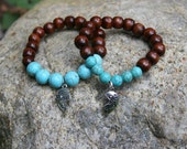 Mother and Daughter Yogi inspired Buddha bracelets with wood beads, turquoise beads and puzzle charms