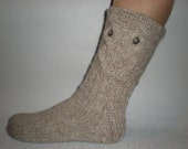 Hand-knitted oatmeal color women socks with owl pattern