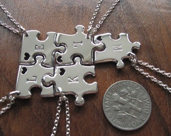 Five miniature jigsaw puzzles with hearts and initials pendants necklaces