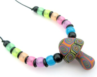 Glow in the dark mushroom pendant necklace, handmade, polymer clay, millefiori spiral patterns, glow in the dark beads, rainbow