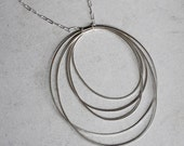 Large Five Hoop Necklace, concentric orbiting circles, silver chain, modern jewelry