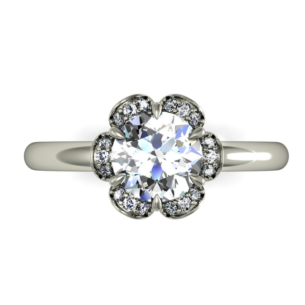 engagement ring with diamonds and moissanite floral design in