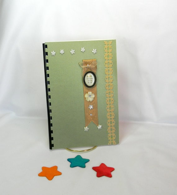 Username and password journal metallic green with a follow your bliss bookmark
