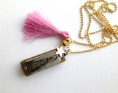Harmonica charms necklace with bright pink tassel