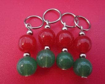A set of 4 acrylic red and green bead stitch markers for knitting - fits needles up to size 4.00 mm