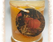 pumpkin colored scented soy candle