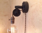 Industrial Pulley Sconce Lamp. Plug in.