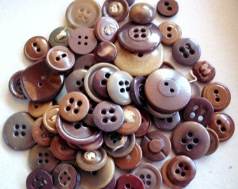 Lot of more than five dozen mixed size/style brown plastic buttons