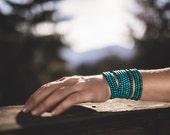 Turquoise wooden beads on elastic string Handmade Bracelet