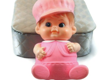 """Squeaky rubber doll, made in Japan 1968 by IWAI. 7"""" tall  light brown hair, blue eyes and a smile"""