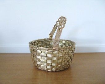 Woven brass basket with braided handle