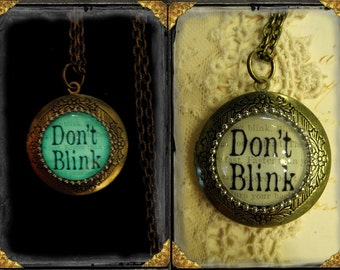 """Doctor Who """"Don't Blink"""" glow in the dark locket in aged bronze, Time Travel, Time Lord, Geekery, Sci Fi, BBC, TV, Fantasy"""