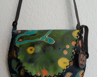 A painted handmade leather purse/bag