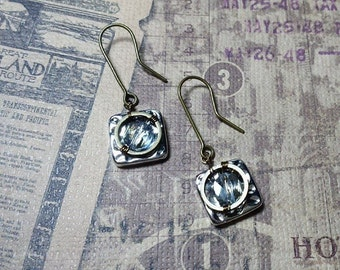 Silver and brass earrings with light blue crystal