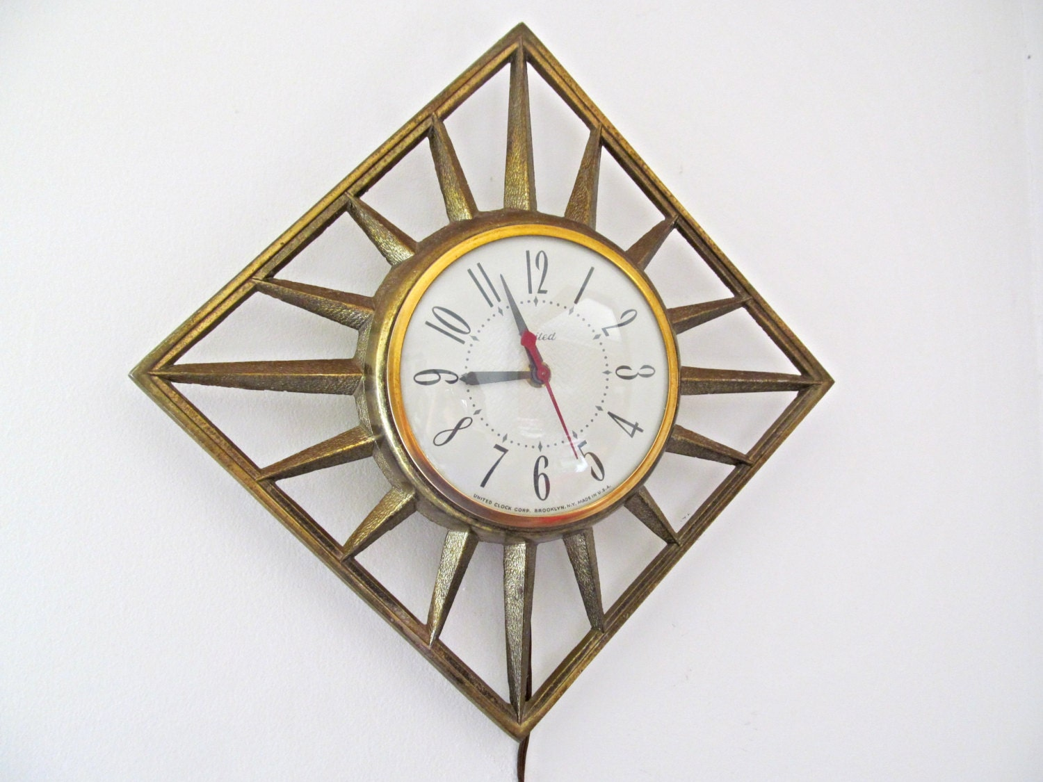 vintage gold metal wall clock sunburst united mid century. Black Bedroom Furniture Sets. Home Design Ideas
