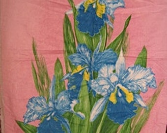 Blue Irises on a pink background with green leaves. 1/2 yard X 44 inches #120