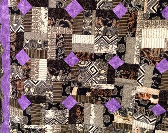 Black&bright lilac quilted throw.