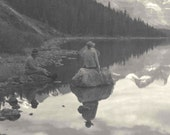 vintage 1920s photograph. Jasper National Park, Alberta, Canada. Woman hiker, lake. Black and white. Rustic woods, camping, outdoors,lake.