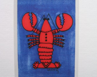 Colorful, original, mini lobster print, framed in white mat board.