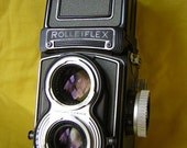 Superb Rolleiflex 3.5T medium format twin lens camera with mirror lens covers