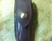 Closed top leather sheath for the Buck knife 110 and 112