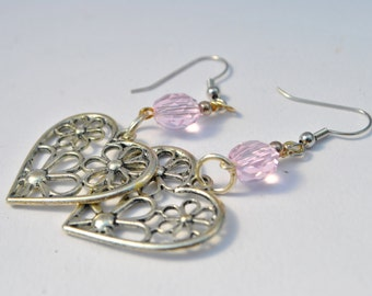 Floral heart silver tone metal earrings with soft pink crystals