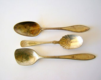 three silver plate serving spoons