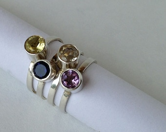 Stacking Ring in Sterling Silver with a Dark Blue Sapphire