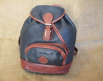 Vintage black leather backpack rucksack made in Canada carry all