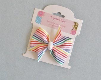 """Medium 2 1/2"""" Pinwheel Bow -  Rainbow Stripes on White"""