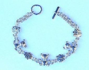 Sterling Silve Teddy Bear and Flower bracelet