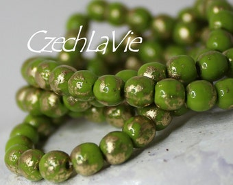 4mm Czech Druk BeadsOpaque Avocado color and gold color, venetian style (016)