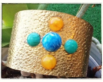 Brass bracelet with semi precious stones.  one size fits all. Made by an Ethiopian artist, Parsugian