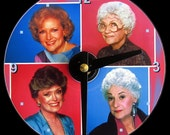 GOLDEN GIRLS Wall Clock - CD Size, 4.75 inch diameter. Betty White, Bea Arthur, Rue McClanahan, Estelle Getty. Clock makes a nice gift.