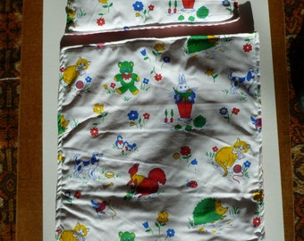 Dolls cot blanket with pillow.