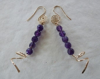 Deep rich purple amethysts stacked above gold curls swing on my spiraled French earwires -  Violet's Earrings