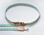 Green Geo Hands free dog leash and double dog leash. Handmade leather dog lead with green geometric printed fabric and leather.