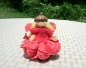Red flower fairy child