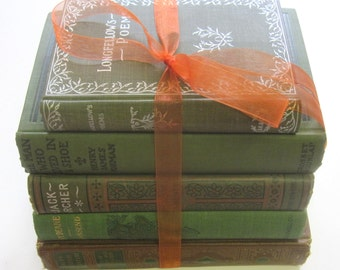 Collection of green, brown and orange vintage and antique books. Good reading, great props or decor.