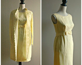1960's lemon yellow sleeveless knee length dress with lace over jacket. Size small.