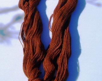Suri alpaca and orange merino yarn in 2 ply worsted skein