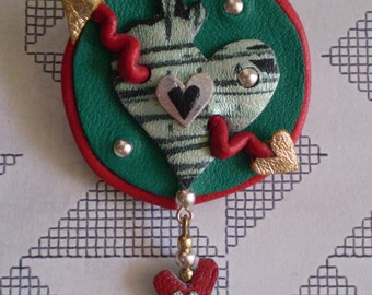 Beautiful Hearts and arrow Brooch in recycled Red and Green leather.