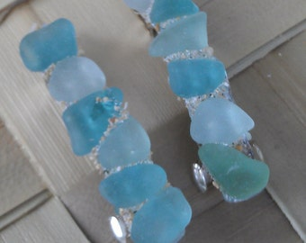 Hair barrettes of Maui seaglass in shades of blue.