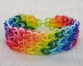Rainbow Loom bracelet made from rubber bands, multicolor, 12 colors and glow in the dark in the background