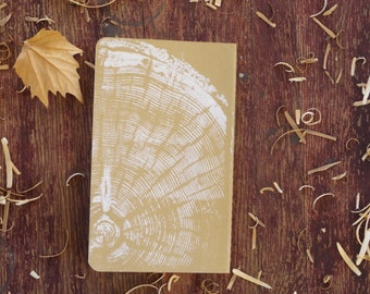 Journal with tree ring print. Moleskine Cahier notebook with pine tree print.