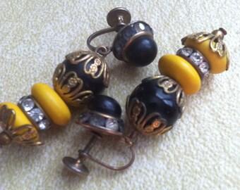 Yellow bakelite black stacked beads and rhinestone earrings