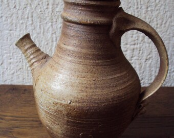 Rare manufactured handcrafted wine jug.